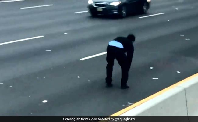 Cash Spills On Highway From Truck, Chaos Ensues. Watch