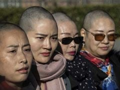 """""""Want Answers"""": Wife Of Detained China Activist Goes Bald For Justice"""