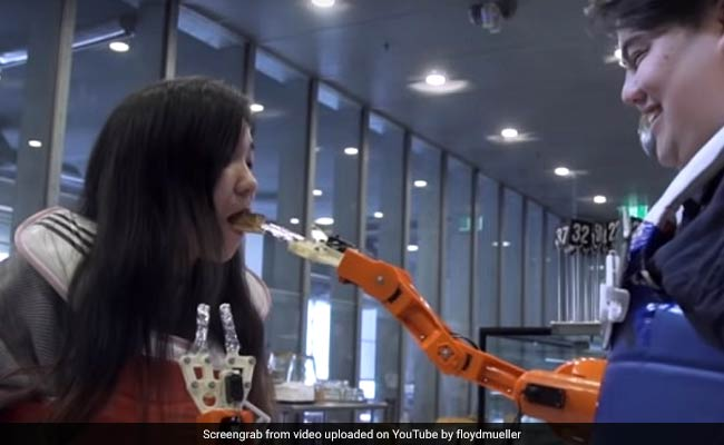 Arm-A-Dine: A Robotic Arm That Feeds You Food, But Only If You Smile