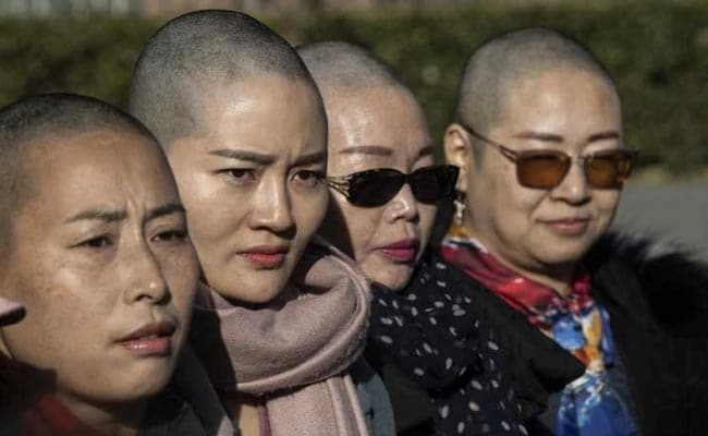 'Want Answers': Wife Of Detained China Activist Goes Bald For Justice
