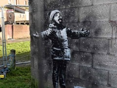 New Banksy Artwork Brings Crowds To Welsh Town