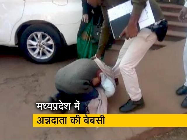Videos : न्यूज टाइम इंडिया: कलेक्टर के पैरों में गिरा किसान