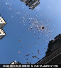 Millionaire Throws Cash From Building, Sparks Frenzy. Video Is Viral