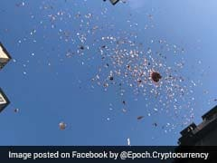 Millionaire Throws Cash From Top Of Building, Sparks Frenzy. Video Is Viral