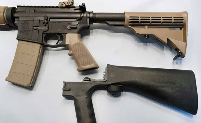 A bump fire stock that attaches to a semi-automatic rifle to increase the firing rate