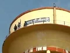 3 Men Climb Up A Tank In Rajasthan, Scream Support For Sachin Pilot