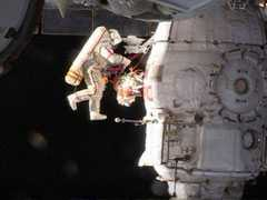 Russian Spacewalkers Inspect Mystery Hole At International Space Station