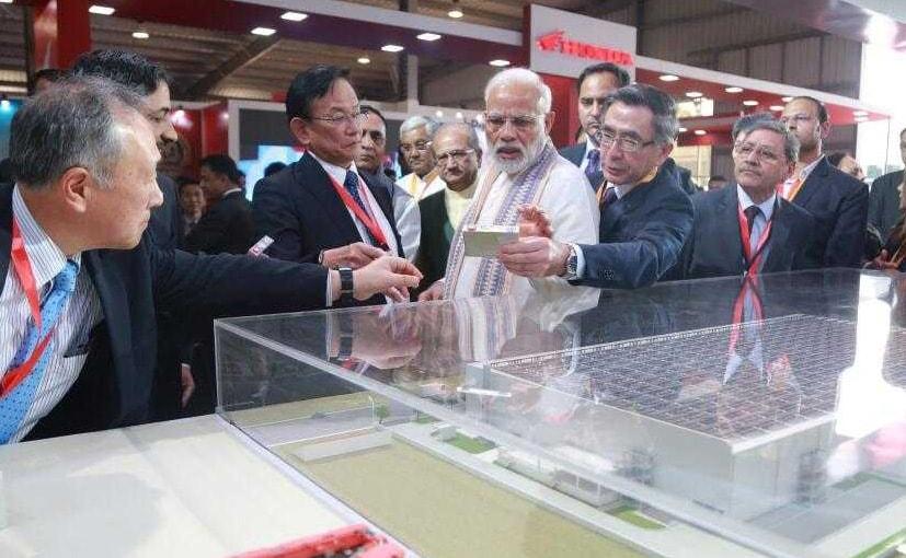 Maruti Suzuki's MD, Kenichi Ayukawa and Toshihiro Suzuki, President, Suzuki explain the model To PM Modi