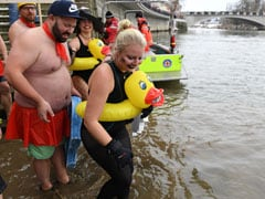 """In Icy River Just Above Freezing Point, """"Naked Swimmers"""" Test Their Nerve"""