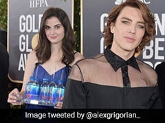 'Fiji Water Girl' Photobombed Every Golden Globes Red Carpet Pic And Twitter Loves It