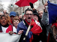 """Red Scarves"" Protesters March In Paris Against ""Yellow Vest"" Violence"
