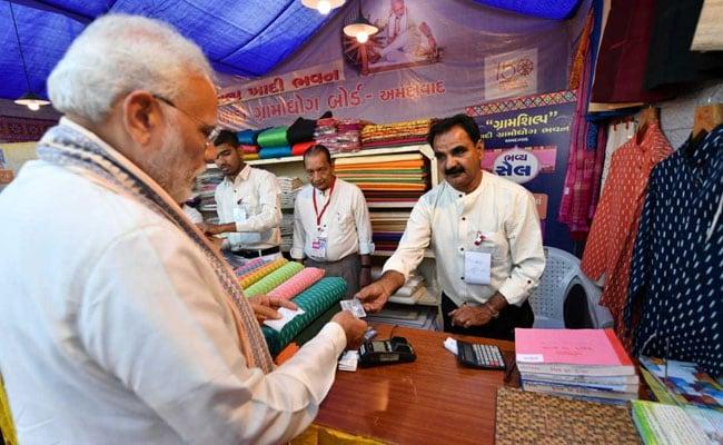 PM Pays For Khadi Jackets With RuPay Card At Ahmedabad Shopping Festival
