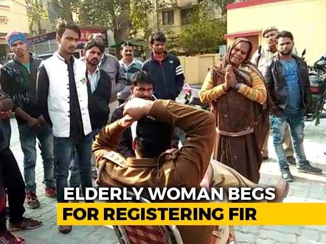Video : UP Cop Shifted Out After Video Shows Elderly Woman Pleading At His Feet