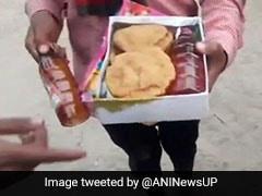 BJP नेता नरेश अग्रवाल के बेटे ने मंदिर के बाहर खाने के पैकेट में बांटी शराब की बोतलें, सामने आई तस्वीरें