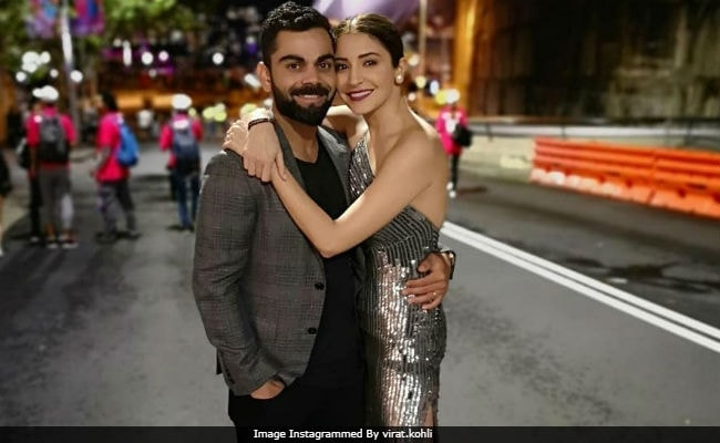 Virat Kohli and Anushka Sharma celebrate India's big win against Australia