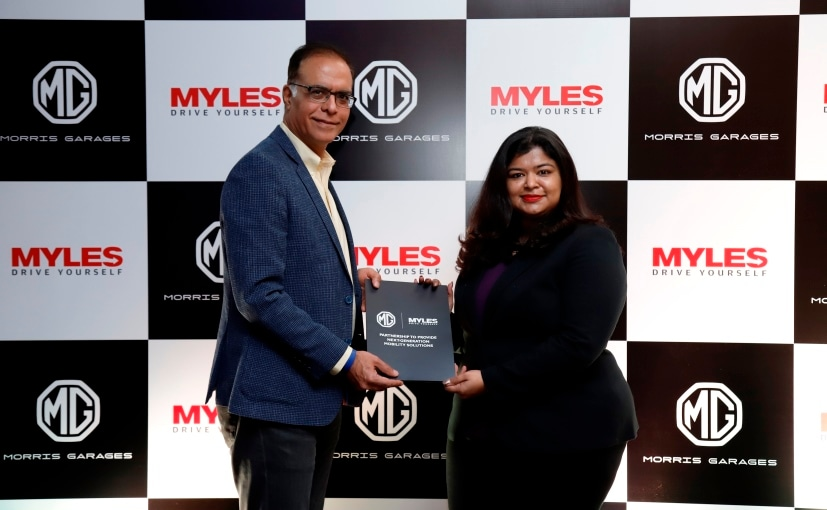 Rajeev Chaba, President & MD, MG Motor India With Sakshi Vij Founder CEO Myles during Tie-up Ceremony