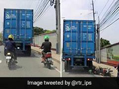 ट्रक के नीचे आ गया बाइक ड्राइवर, टायर निकला सिर के ऊपर से तो देखें क्या हुआ, वायरल हुआ VIDEO