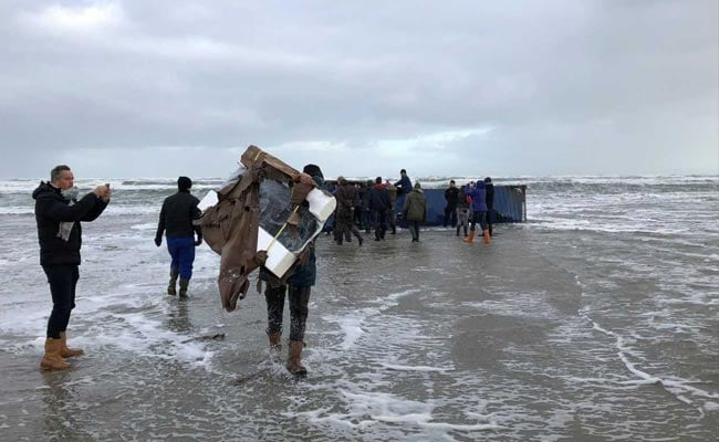 Rubbish and goods wash ashore as 270 containers lost off Dutch coast