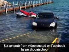 """""""Can't Buy Common Sense"""": Owner Trolled For Driving Porsche Into Ocean"""