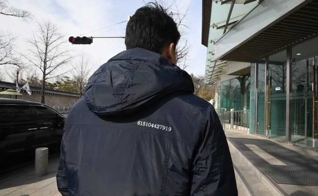 Fashion Diplomacy: South Korea Officials Don Coats With Secret Message To Kim Jong Un