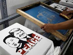 """Make Love Not War"": Hanoi T-Shirt Designer Earns Bread From Trump-Kim Mania"