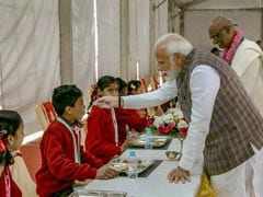 Watch: PM Modi, Yogi Adityanath Serve Food To Children In Vrindavan