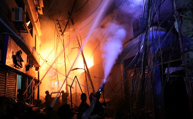 Dhaka fire: Blaze kills dozens in building