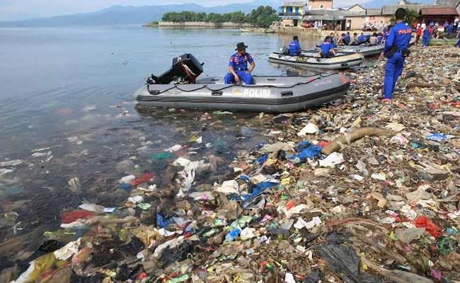 Indonesians Clean Up The Beach One Sandal At A Time