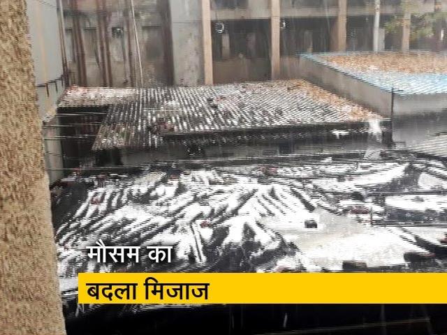 Videos : दिल्ली-NCR में बदला मौसम, नोएडा में गिरे ओले