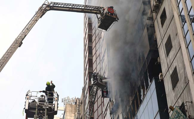 17 die as high-rise office building catches fire