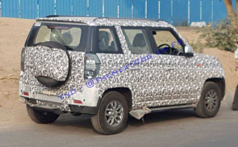 The Mahindra TUV300 facelift gets new smoked lens tail lamps and spare wheel cover.