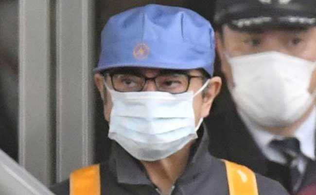Ex Nissan Boss Ditches Tailored Suit, Leaves Prison In Workman's Clothes