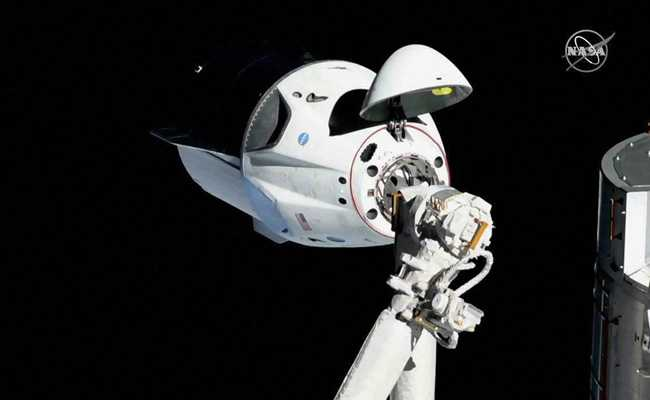 SpaceX's New Astronaut Capsule Docks On International Space Station
