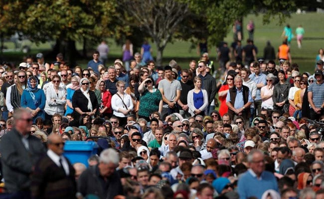 People attend Friday prayers at Hagley Park outside Al Noor mosque in Christchurch