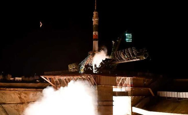 Crew from aborted Soyuz capsule dock safely at ISS