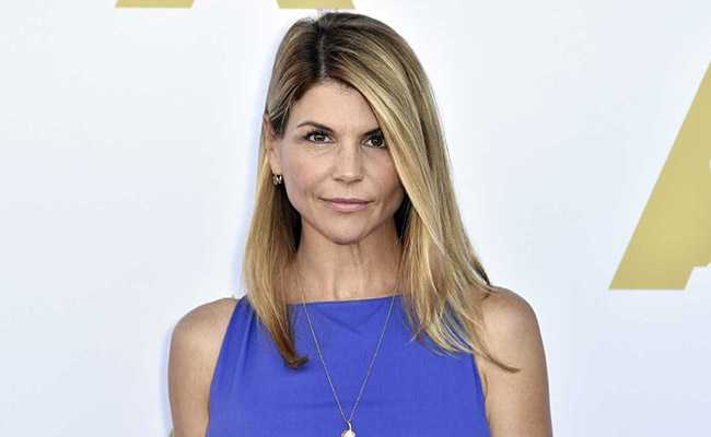Full House star Lori Loughlin taken into custody in college cheating scandal