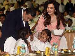 Mukesh Ambani, Wife Nita Serve Food To 2,000 Kids Ahead Of Son's Wedding