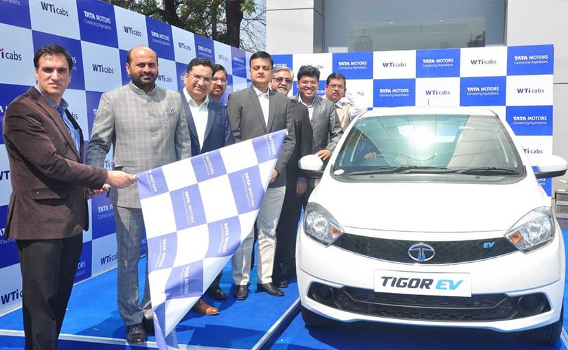 Representatives from Tata Motors and Wise Travel India Flag off the first batch of Tigor EVs