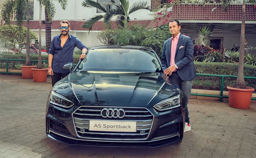 Actor Ajay Devgn with Audi India Head - Rahil Ansari pose with the A5 Sportback