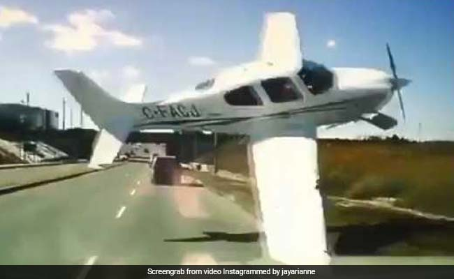 Dashcam video of small plane skidding across road near Hwy 404