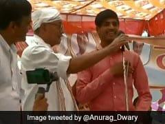 Election 2019: दिग्विजय के मंच से PM मोदी की तारीफ करने वाले युवक को BJP ने किया सम्मानित, जानें पूरा मामला