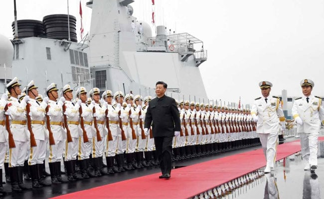 China shows off new destroyer as Xi views naval parade