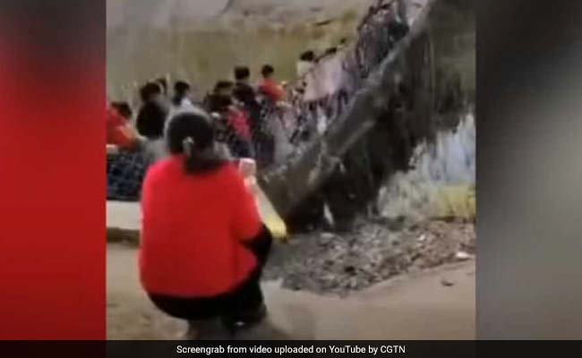 Caught On Camera: Tourists Plunge Into Water After Bridge Collapses