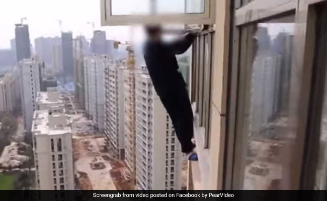 Watch: Man Climbs Out Of 23rd-Floor Window In Attempt To Escape Cops
