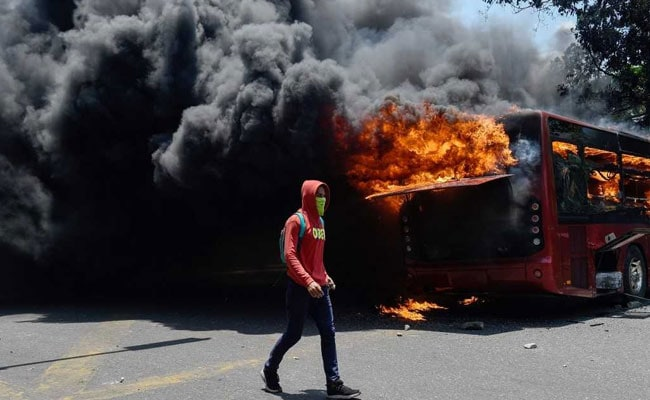 Military Vehicle Rams Protesters In Venezuela Clashes, Shows TV Footage