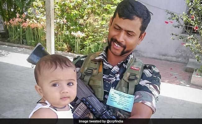 CRPF Jawan Babysits Toddler As Mother Votes In Phase 3 Of Elections