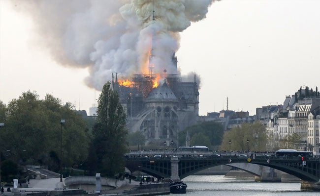 Spire Atop Paris' Iconic Notre Dame Cathedral Collapses in Massive Fire