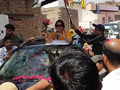 """""""No Bed Of Roses"""":  BJP Candidate Hema Malini's SUV Sunroof Campaign"""
