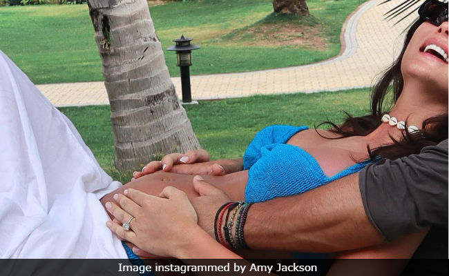Pregnant Amy Jackson Chills With Fiance In Dubai, Writes 'Bump Spam Has Started'