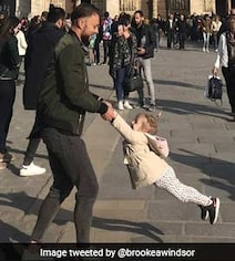 Twitter Helps Find Man, Girl Behind Happy Photo Outside Notre-Dame Paris